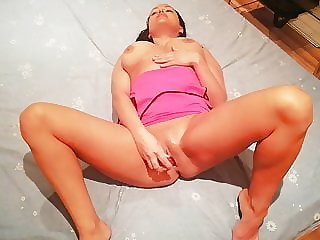Mom plays with a rubber cock