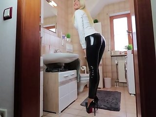 German babe in latex gets fucked in the bathroom