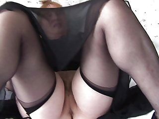 Mature busty granny shows off hairy pussy in black lingerie